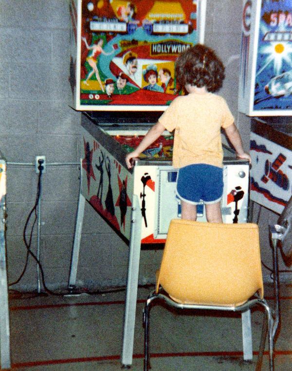 1979ish-clint-playing-pinball-by-dad_l