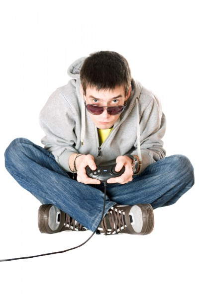 Young man in sunglasses with a joystick