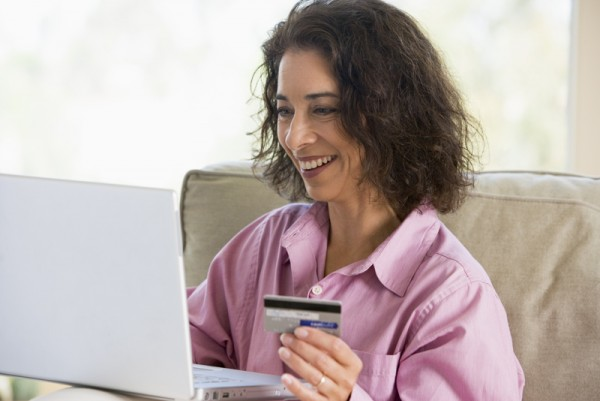 Woman shopping online at home with credit card