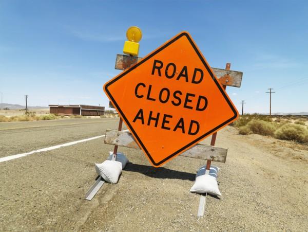Road closed ahead sign.