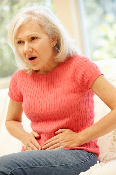 Mid age woman with stomach ache