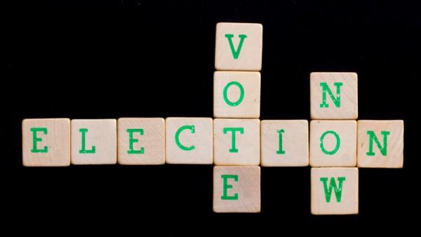 Letters on wooden blocks (vote, elaction, now)