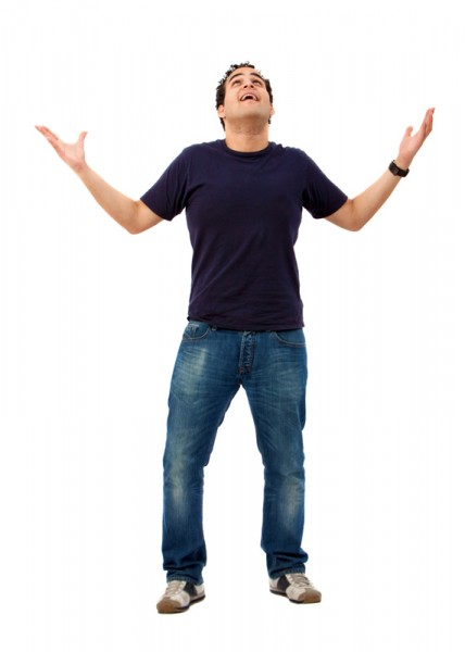 Casual happy man looking up with opened arms isolated on white