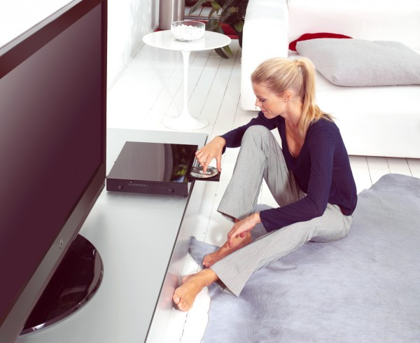 woman using dvd player