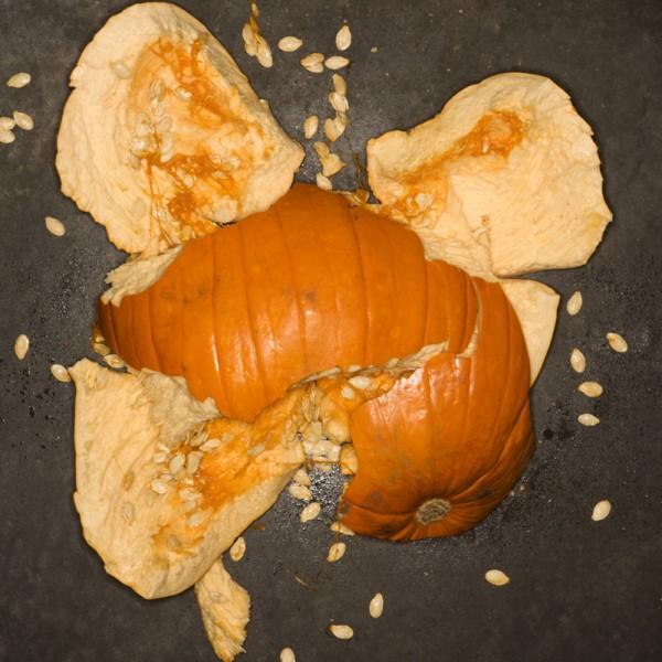 Pumpkin smashed on concrete floor.