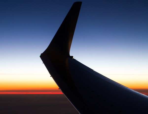 wing aircraft at sunset