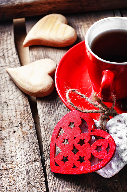 Cup decorated with wooden hearts