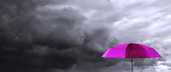 umbrella under cloudy sky
