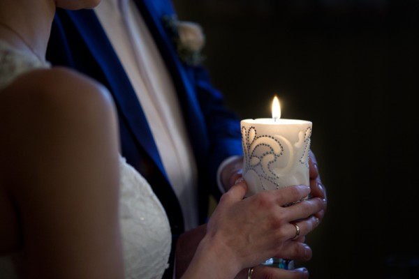 bride and groom holding a candle