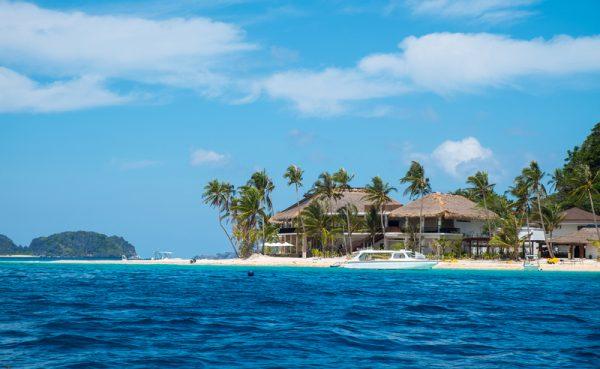 Villa on white sand tropical beach